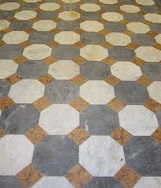 Italian marble tiles in classic patterns -- pretty on a small powder room floor