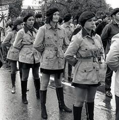 """Chicana Brown Berets at the 2nd Chicano Moratorium in February 1970 in East LA. The """"March in the Rain"""" with 7,000 people marching to end war in Vietnam..."""