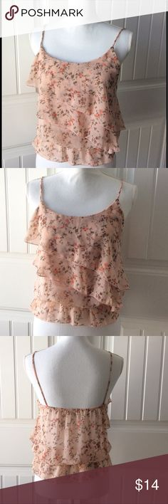 🍑Pretty Peachy Floral Tank Top🍑 Pretty light peach colored floral tank top.  Tiered ruffles in the front.  Sheer and flowy fabric.  Elastic waist.  100% polyester.  Great condition! Tops Tank Tops