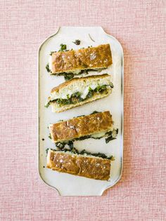Upgrade your grilled cheese sandwich with this recipe served on focaccia or ciabatta and stuffed with shredded kale, olive tapenade and Taleggio - a delicious lunch!
