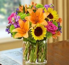 Dad's like flowers too! It's not too late to send a cheerful bouquet for Father's Day...Call or order online!