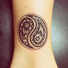 Tribal inspired Yin Yang tattoo. Very simple yet interesting to look at. A good tattoo to pace on someone's wrists or arms.