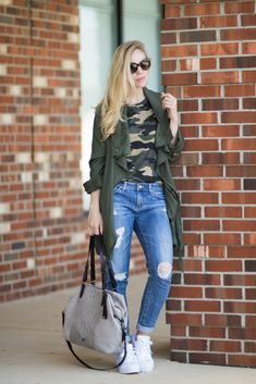 Camo Comeback: olive utility jacket with camo print tee, distressed denim, Adidas white Superstar sneakers, Brahmin 'Delaney' suede tote, how to wear camo, camo shirt outfit, utility jacket outfit with distressed denim