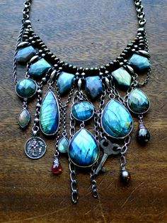 Incredible Labradorite Shield Necklace.  AAA quality faceted labradorite bead pendants hang asymmetrically with sapphires from natural pearls. An amazing statement piece for you labradorite lovers.