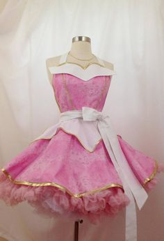 **HALLOWEEN ORDERS ARE CLOSED** You wont be sleeping in this stunning Sleeping Beauty apron! One of my new SassyFras Fairy Tale aprons, Aurora, Sleeping Beauty is a 2-tier circle skirt pinup design that is very feminine, flirty, and fun! Aurora couldnt decide between the pink or