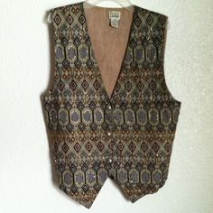 The Halsey Collection Vintage Vest An embellished/beaded vest. A few beads have fallen off due to its old age, but it was already like that when I bought it. 3 buttons in the front. Adjustment ties in the back Navy blue, Gold, Burgundy, Tan. 100% Cotton The Halsey Collection Jackets & Coats Vests