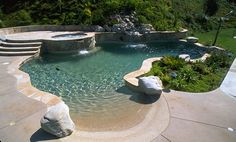 beach entry pool- shallow enytry transistion to shallow end- long shallow platform to enjoy