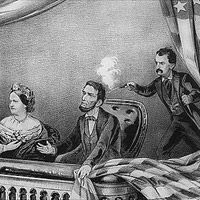 Shortly after 10 p.m. on April 14, 1865, actor John Wilkes Booth entered the presidential box at Ford's Theatre in Washington D.C., and fatally shot President Abraham Lincoln. As Lincoln slumped forward in his seat, Booth leapt onto the stage and escaped through the back door. A doctor in the audience rushed over to examine the paralyzed president. Lincoln was then carried across the street to Petersen's Boarding House, where he died early the next morning.