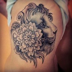 Pretty lioness head with a flower on back