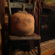 Prim October...old chair with grungy handid' punkin'.
