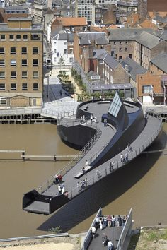 This is an amazing footbridge over the River Hull in Kingston upon Hull, England, designed by McDowell+Benedetti Architects. This innovative swing bridge is Ouvrages D'art, Kingston Upon Hull, Hull City, Bridge Design, Pedestrian Bridge, Over The River, Civil Engineering, Chemical Engineering, Urban Design