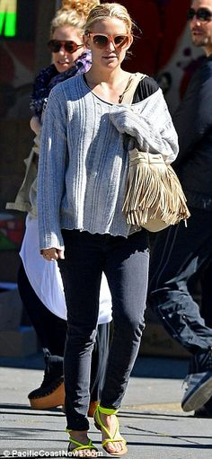 Casual chic: Kate looked low key but stylish in a baggy grey sweater, black jeans and neon sandals