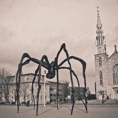 Maman      Maman (1999) is a sculpture by the artist Louise Bourgeois. The sculpture, which resembles a spider, is over 30ft high and over 33ft wide, with a sac containing 26 marble eggs. Its abdomen and thorax are made up of ribbed bronze.  The title is the familiar French word for Mother.    This in Ottawa:D