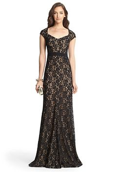 DVF black lace cap sleeve gown with sweetheart neckline and black band belt.