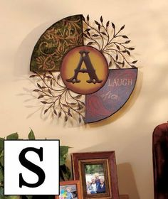 """Monogram Wall Hanging Letter S . $36.00. A Monogram Wall Hanging will add beauty to your home as it inspires you with its sentiment. Nearly two feet in diameter, this stunning metal wall decor pairs graceful leaf accents with decorative panels that display the reminders """"Live simply and """"Laugh often."""" The single bold letter in the center adds a distinctive look to your decor. Each measures 20"""" dia. x 2"""" overall. Sawtooth hanger for easy hanging.  Customize a wall of your home w..."""