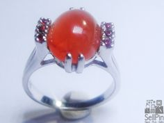 SellPin.com: Pins for Sale by Owner: Pure orange Nigerian carnelian mounted in 925 sterling silver with ruby side stones. So nice, you would swear it was candy. Rhodium overlay. Size 6 Can be sized up or down