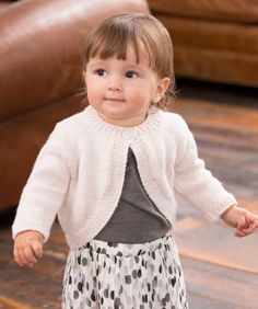 Knit the perfect shrug for a baby girl! The fashionable single-button styling ensures that the sweater stays on.
