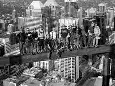"""Photographed Fall of 2011 at 770 vertical feet, overlooking the City of Calgary. The photograph was taken as homage to the 1932 image of the Rockefeller Centre and its workers, titled """"lunch atop a Skyscraper. Calgary Bow Tower"""