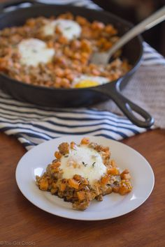 Sausage and Sweet Potato Hash with Baked Eggs - This Gal Cooks. A savory breakfast dish made with chicken sausage. #healthy #breakfast #sweetpotato