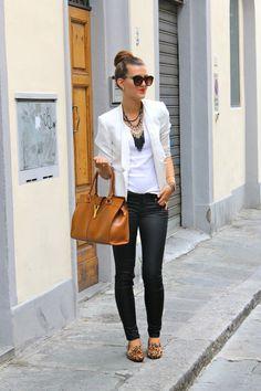 chic street style   white blazer   white top   black pants   leather bag   sunglasses   high bun   fringe necklace