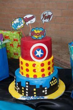 Fun decorated three layer cake at a Superhero Party #superhero #partycake