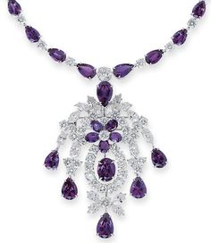 [DETAIL] A FINE ALEXANDRITE AND DIAMOND PENDENT NECKLACE/BROOCH   The detachable pendant designed as a diamond foliate cascade with alexandrite flower head centre and drop-shaped terminals to the graduated pear-shaped alexandrite and brilliant-cut diamond necklace, the pendant may also be worn as brooch, 41.0 cm long