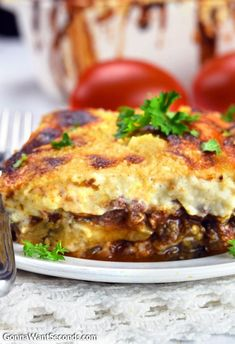 This Greek Moussaka Recipe Is comfort food at its finest. A hearty, ooey gooey casserole made with delicious layers of a rich Tomato Meat Sauce and a luscious, creamy Cheese Sauce layered with Eggplant. Paleo Snack, Mousaka Recipe, How To Make Cheese Sauce, Pot Pasta, Meat Sauce, Greek Recipes, Greek Meals, The Fresh, Snacks