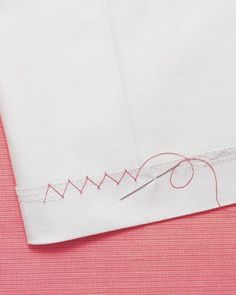 """See the """"Sew Diagonal Stitches"""" in our How to Patch a Hole, Mend a Seam, and Fix a Hem gallery"""