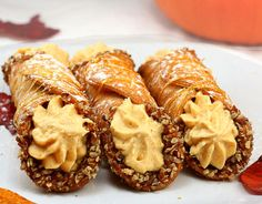 Pumpkin cheese filled cannoli dipped in caramel and pecans then wrapped with spun sugar.