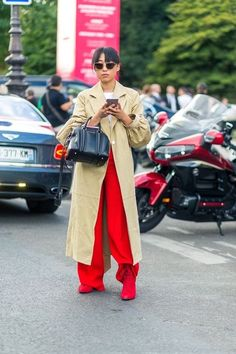 Marget Zhang (in Tome coat, Maison Mayle pants and Stella Luna boots) at Paris Fashion Week, Spring 2017 in October 2016.    Photo by Diego Zuko.