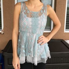 Sheer lace blouse Has a slit in the front but looks like part of the style. Altard State  Tops Blouses