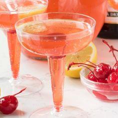 Pink Lemontini Champagne: Vodka, Limoncello, Sweet And Sour, Lemon Juice, Grenadine, Champagne, Lemon Slices, Maraschino Cherries.