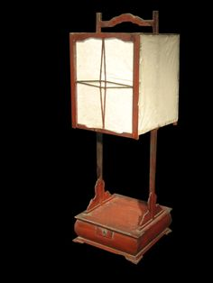 "Delicate wooden andon with rice paper panels. 19th Century. 11.5"" x 11.5"" x 34""H"