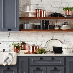 """Kitchen colors..dark blue gray cabinets, brass, creamy whites and butcher block. 10.2k Likes, 96 Comments - Martha Stewart (@marthastewart) on Instagram: """"Who's starting their spring cleaning this weekend? Organized #kitchengoals courtesy of our…"""""""