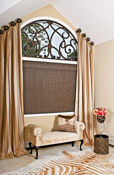 An arched window dressed in a beautiful angled panels, finished with a custom faux iron piece and a woven woods with silk window shade, gives this room a very romantic and luxurious look. Yes we do faux iron! Arched Window Treatments, Custom Window Treatments, Faux Wood Blinds, Living Room Remodel, Window Design, Foyers, Basement Remodeling, Basement Ideas, My New Room