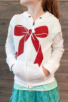 Bow Hoodie made with Cricut Red Glitter Iron-on. Make It Now in Cricut Design Space.