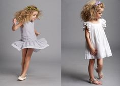 Sweet little girls in pretty clothes.