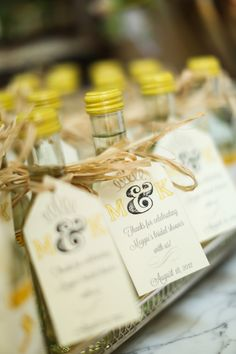 Learn how to make these chic wine bottle wedding favors Mini