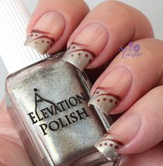 Paint nails clear. French tip with silver (Don't go to far down. See pic). Let dry. Use detail brush and a rust to brown polish swirl the design towards tip and towards bed (see pic). Use small dotting tool with same brown or rust polish (see pic). Let dry completely. Clear coat. Dry. Done.