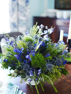 Blue and green thistles for a seaside wedding by Holly Chapelle