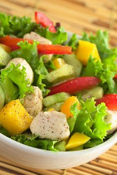 Mango Chicken Salad    In addition to the rich nutritional value of the dark, leafy greens, this fresh and filling entrée gets a boost of vitamin C from mango and red pepper. Sliced almonds and boneless chicken breast add protein.