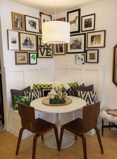 Is there a corner in your home used more than the others – such as this kitchen seating area, with built-in banquette seating, tucked into this lovely corner?!? If so, emphasize this space and bring some style in with a gallery wall of custom framed art! It will make it a more inviting space for guests.