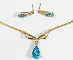 Lot 274: 14k, 10k Gold, Blue Topaz and Diamond Jewelry Suite; Including a necklace having an attached pendant and a pair of pierced earrings; all adorned with diamond chips