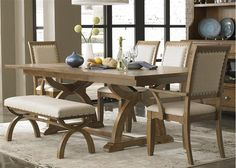 We can't get over how beautiful this Liberty Furniture dining set is! Light wood, light cloth, thick padding, brass accents, AND under table architecture! This will wow all of your guests! #Sherman's #dining #beauty