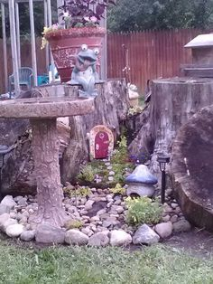 My fairy garden, door idea from a fellow pinner, the rest all me...look for 2014 pics of added fairy door on the other side love creating....