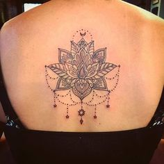 Flower mandala tattoo on back done by Chelsea Soto