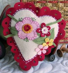 A Wool Applique heart with a lacey fluted edge and pretty blossoms.  Use some traditional penny rug wool applique techniques PLUS add texture with flowers, leaves and branches with raised edges.  Fill your pin cushion sachet with wool fleece and lavender buds for a sweet scent.