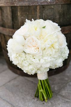 The bouquets were filled with hydrangeas, peony's, roses and garden roses. The flower combination was simply exquisite. My bouquet was all white.
