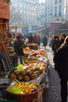 """Rue Mouffetard market in the Latin Quarter, Paris. Being one of the oldest parts of Paris Rue Mouffetard feels like a very awake village in a big city. Rue Mouffetard main attraction is its regular open market with its street stalls and their vendors."" -- says someone else who knows a lot more about this photo than I do."