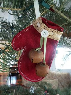 mitten ornament. Make one for each family member using their hand. Hang on wall instead of tree.